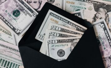 A picture of 20-dollar bills in a black wallet. Borrow by Luxury Asset Capital.
